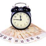 Wecker und Geldschein - Zeit ist Geld